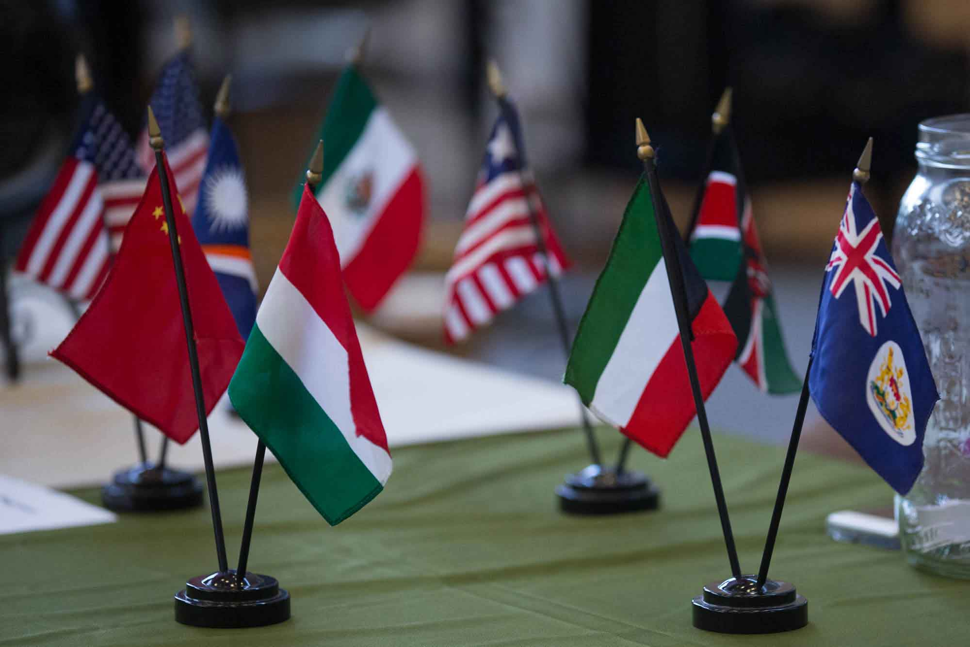 Tiny international flags decorate a table