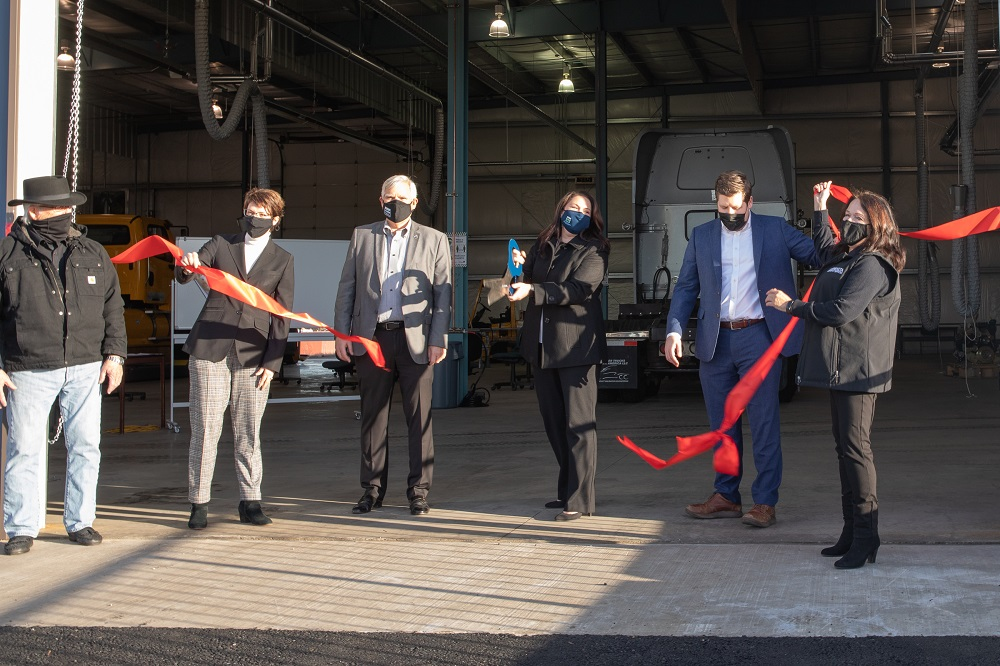Marion County Commissioners and Chemeketa officials cut the ribbon at the new Diesel training center